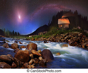 The Milky Way and the moon over the mountains - On the banks...