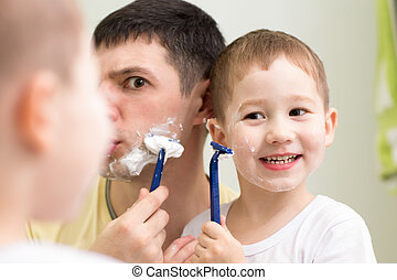 Funny man and son little child shave looking at mirror in...
