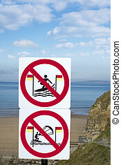large warning signs for surfers in ballybunion - warning...