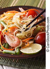 Thai green papaya salad som tam closeup. vertical - Thai...
