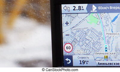 GPS in car showing way, speed and distance