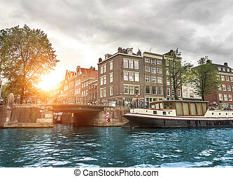 Channels of Amsterdam. - Water channels and the streets of...