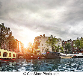 Channels of Amsterdam - Water channels and the streets of...