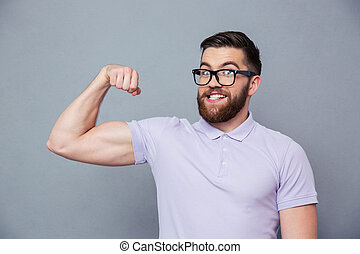 Funny man in glasses showing his muscles - Portrait of a...