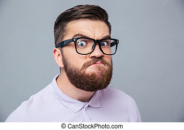 Funny hipster man looking at camera - Portrait of a funny...