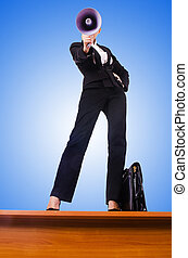 Businesswoman shouting through loudspeaker
