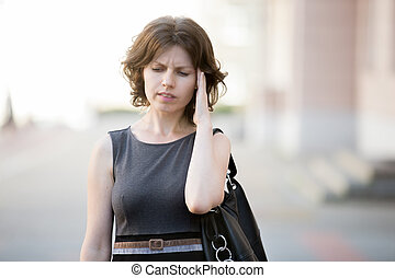Bad memory - Portrait of young office woman walking on the...