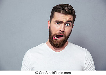 Man with stupid mug - Portrait of a man with stupid mug over...