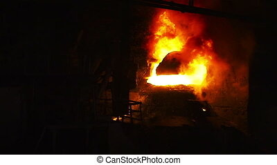 Fire during oxygen blowing metal - Pouring of liquid metal...
