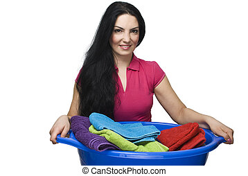 Woman holding laundry basket with towels - Young brunette...