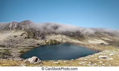 time lapse over mountain lake