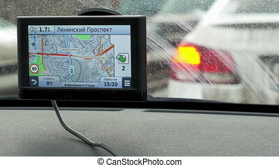 Timelapse of car on stop, GPS in foreground - MOSCOW, RUSSIA...
