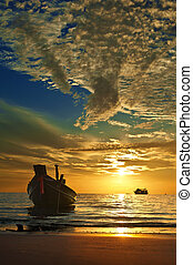 Small Thai boat at tropical sunset, Koh Tao, Thailand