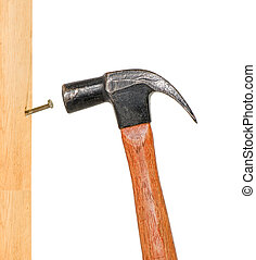 Vertical Pounding Nail - Hammer pounding a nail in a wooden...