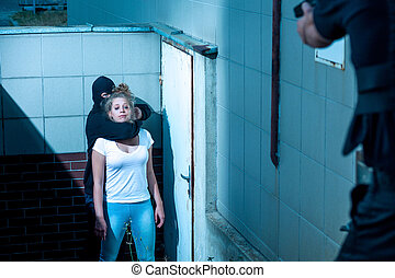 Scared and defenceless woman - Gunman is holding scared and...