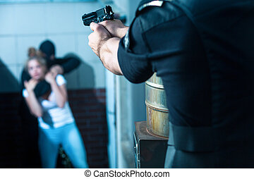 Aiming to the criminal - Police officer is aiming to the...