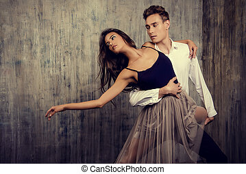impression - Beautiful couple of ballet dancers dancing over...