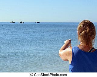 Woman Pointing to Ships at Sea Sanibel Florida
