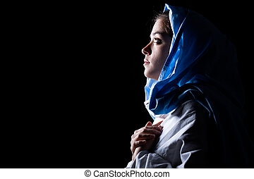 Virgin Mary with Blue Veil Praying on Black Background