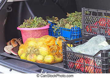 Loaded car trunk - Vegetables and fruits in a large trunk of...