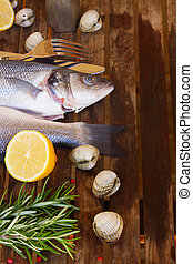 Seabass - Two Seabass raw fish on wooden table close up