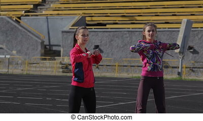 Young girls spend training exercises before the race at the...