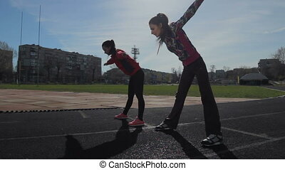 Young girls spend training exercises before the race....