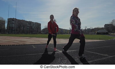 Young girls spend training exercises before the race. leg...