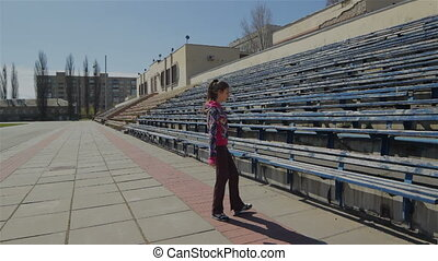 Young girl doing gymnastics exercise at the stadium....