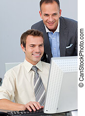 Mature manager checking his employee\'s work