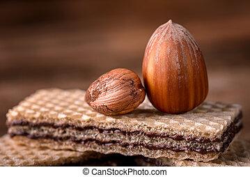 wafer and hazelnut on wood