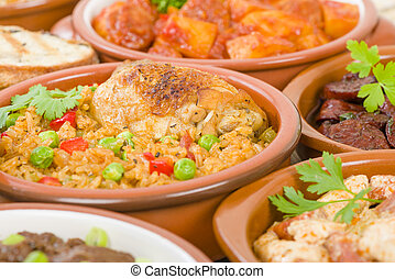 Arroz Con Pollo - Chicken and rice cooked with sofrito and...