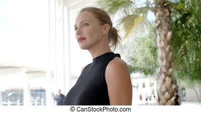 Attractive Businesswoman in Urban Scene of Bright City,...