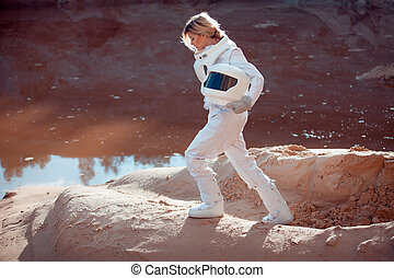 Water on Mars, futuristic astronaut without a helmet in...