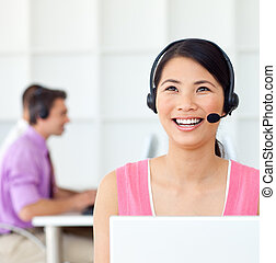 Laughing Customer service representative using headset in...