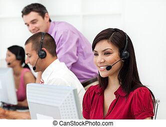 Smiling Customer service representative with headset on in a...