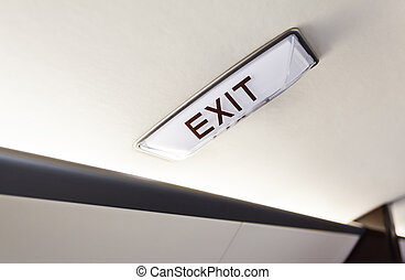 interior in business aircraft with exit sign - Luxury...