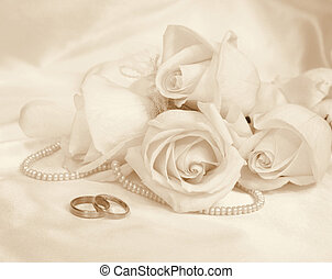 Wedding rings and roses. In Sepia toned. Retro style