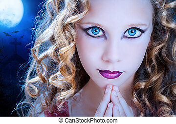 Girl with ice blue eyes at halloween. - Extreme close up...