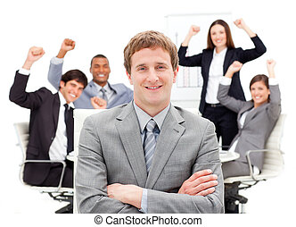 Succesful business team punching the air in a meeting