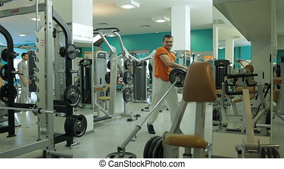 Young man doing exercise with barbell - young man doing...