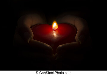 Giving my flaming heart - Womans hands holding a burning wax...