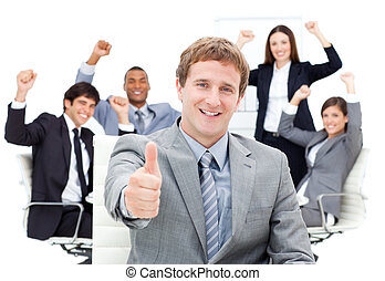 Positive business team showing thumbs up against a white...