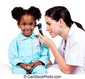 Female doctor checking her patients ears against a white...