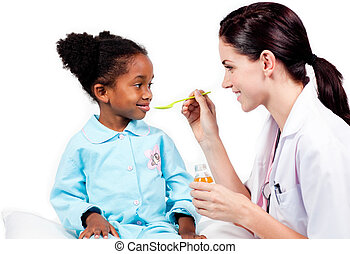 Sick little girl taking medicine against a white background