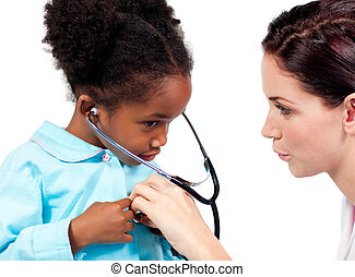 Cute little girl and her doctor playing with a stethoscope...