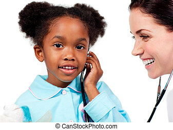 Adorable little girl and her doctor playing with a stethoscope