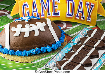 Cookies and cake. - Close up of football shaped brownies and...