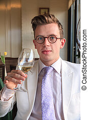 Oenologist - Beautiful and well dressed young man enjoying...