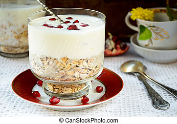 Healhty breakfast with oatmeal, yogurt and pomegranate...